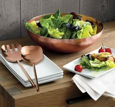 High-style serving in gorgeous, glamorous copper. Our handcrafted bowl starts out in stainless steel, softly hammered to create the rich texture and welded to form the artisanal molten-edge detail. The exterior is then copper plated and polished to a shiny gleam, with a foodsafe lacquer finish allowing serving of salads, pasta and other dishes.