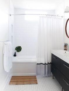 a teak bathmat adds visual interest to a clean + modern bath   via coco+kelley