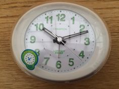 Champion Traditional Oval Silver Quartz Silent Sweep No Tick Alarm Clock MF888S