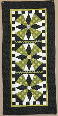A whimsical design...love the black and white checked border...would look equally as nice in other colors too.