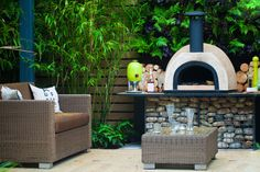 Beautifully crafted mini outdoor pizza oven and chimney built over pebble base and deck with seating