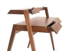 Primary Desk Designed by Nathan Yong. Measurements: H 37.75″ W 47.25″ D 30″ Materials: Solid American walnut frame and drawer fronts; walnut veneer over MDF desktop and small drawer boxes.