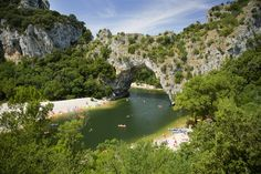 Natural entrance of the Gorges de l'Ardèche, the Pont d'Arc is a natural bridge 60 meters high under which the river continues to flow. A well-known place to canoeists and prestigious site at the foot of which it is good to swim. © Belphnaque - Fotolia.com