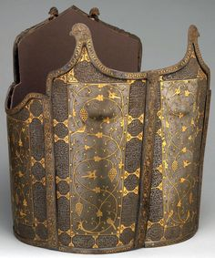 Persian char-aina cuirass, 17th century,(chahar-aina, chahar a'ineh). Literally the four mirrors. Four plates worn over a zirah (shirt of mail) in Persia, India and Central Asia. The armor plates can be rectangular or round, and the two plates worn on the breast and back are considerably larger than those worn at the sides which had recesses for the arms. During the 16th c, char-aina were introduced in Persia, steel; inlaid with gold, H. 14.50 in. (36.8 cm) Diam. 13 in. (33 cm), Met Museum.
