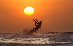 Early morning, I walk on the beach, I saw the little fisherman on a boat, by the light of dawn, they went out into the ocean, too dangerous for small boats, but they are the brave sailors. NamDinh Province, VietNam