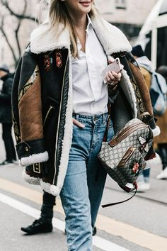 Lessons on layering. Elevating a simple look with a statement jacket and backpack.