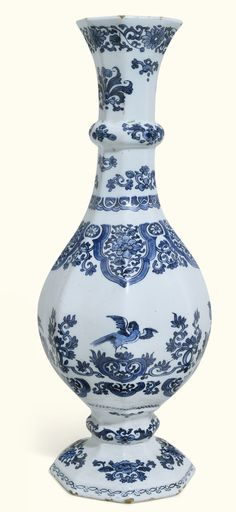 A tall Dutch Delft blue and white octagonal bottle vase, circa 1680-1690 | Lot | Sotheby's