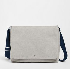 The Eric messenger can be worn comfortably by the adjustable shoulder strap or carried by the grab handle. Two external side zip pockets and a slip pocket on the back provide easily accessible storage. The interior includes a magnetic-secured front compartment, zip pocket, two slide pockets, pen holder, earbud holder and padded sleeve for a 13-inch laptop. Where coated, the twill material is resistant to water.