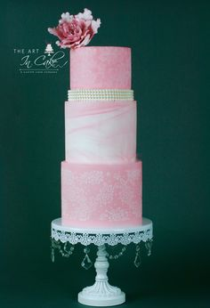 4 tier pink & white cake. For bridal shower, wedding, anniversary or birthday for her. Hand painted peonies, marbled fondant, sugar pearl tier and painted lace netting. Sugar Peony cake topper. www.TheArtInCake.com