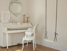 A white shabby chic studio with vintage piano painted white/Louis chair/venetian mirror/and swing from Ikea/Hello Lovely Studio