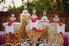 Once You Pop – 11 Low-Key Summer Party Ideas on HGTV My husband would love a popcorn bar! White bags for to go party favors… Dessert Buffet, Candy Buffet, Outdoor Buffet, Popcorn Bar, Popcorn Station, Flavored Popcorn, Gourmet Popcorn, Outdoor Movie Nights, Movie Night Party