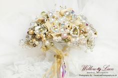 Gold crystal brooch bouquet all hand made from gold silk and swarovski crystals.