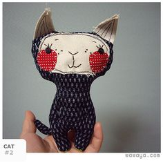 Cute stuffed cat with pretty detailing on her face.