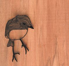 Laser cut bird allowing for far greater detail than anything handmade. Positive/ negative space. D