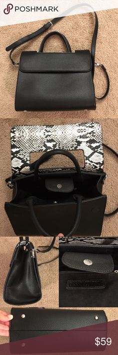 """Dream control very classic bag!! Dream control very classic bag!!   - Used only about 2weeks!  - Like new condition! Bought it for formal area or work but ended up just used less  - black faux leather with silver hardware  - lots of spaces: fits my iPad Air, wallet, makeup, and personal stuff!  - you can also using with lots of accessories because this one is very simple black design!   - magnetic close - measurement: 11""""(L) X 9""""(H) X3""""(Top part D), 5""""(bottom) - 4.5""""( handle) , about 21""""…"""