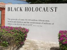 """Black Holocaust"" quote by Martin Luther King at Kura Hulanda, a museum about African slavery. ""THE GENOCIDE OF SOME 50-100 MILLION AFRICAN MEN, WOMEN & CHILDREN & THE ENSLAVEMENT OF MILLIONS OF OTHERS IS THE BLACK HOLOCAUST."""