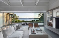 Wicker chairs and plush white sectional sofa anchor the coastal look