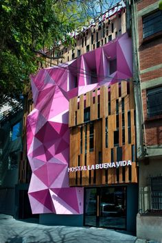 Hostel La Buena Vida | Colorful facade to reduce street noise and control temperature.