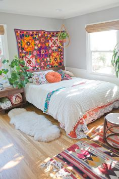 Good idea for tapestry behind bed (but bright colors..yikes!..too bright and busy for restful bedroom)