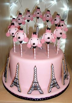 Eiffel tower shaped cookies arranged around a display cake. topped with poodle face cake-pops. Pretty Cakes, Cute Cakes, Beautiful Cakes, Amazing Cakes, Paris Themed Cakes, Paris Cakes, No Bake Cake Pops, Occasion Cakes, Piece Of Cakes