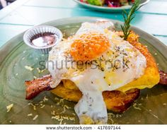 Croque madame delicious french breakfast with bacon, cheese, egg and sausage