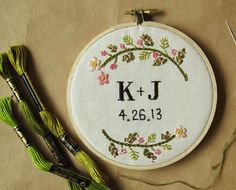 Custom wedding embroidery hoop wall art - spring flowers on linen. $110.00, via Etsy.