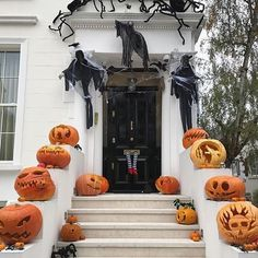 Happy Halloween. Loved this front door display from a home in Chelsea,London. Great carvings but I love the legs hanging out of the letterbox!  Regram from @rvk_loves . . . . #kateabtdesign #interiordesign #design #homedecor #halloween #decorating #decor #architecture #blackfrontdoor #paintedbrick #pumpkins #halloweendecorations #london #greatbritain