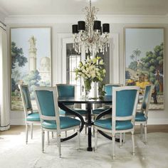 Classic elements such as French-inspired chairs, a crystal chandelier, and painted panels give lend a sense of romantic elegance to this dining room. The turquoise leather upholstery adds a modern touch to an otherwise traditional room.