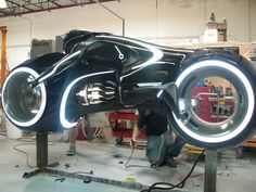 "Tron ""Light Cycle"" - largely made from fiberglass, machined aluminum and acrylic and lit by numerous chained LED's."