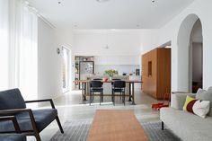 Open plan dining room and living area in bungalow in Palmerston St. Renovation by Vittino Ashe   NONAGON.style
