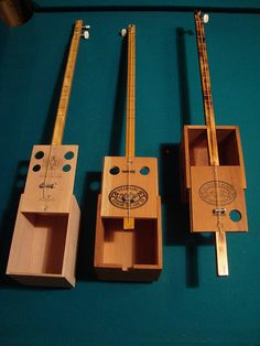 3 single string cigar box guitars by Resist Instrument Works, via Flickr