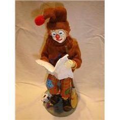 Cute Clown reading the paper.