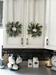 Nice idea for decorating cabinets -  Kitchen Wreaths Holiday Home Tour by SnazzyLittleThings.com