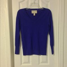 Banana Republic Sweater 100% Merino wool sweater. Worn one time. Still in perfect condition. The color is a royal purple but it almost looks blue. I tried to show true color in photos 3rd one comes closest to it. No flaws, just too warm here for me to get much use out of it. Bundle and Save 25% Banana Republic Sweaters V-Necks