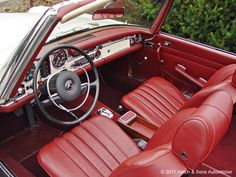 Something about a Mercedes roadster from the 60s with a red interior.....