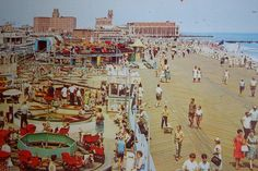 A photograph of the amusements that used to be on the boardwalk, looking north with the Convention Hall and Paramount Theatre in the background. Photo by Kevin Borland. Paramount Theater, The 'burbs, Asbury Park, Beach Images, Vintage Postcards, New Jersey, Great Places, Theatre, The Past