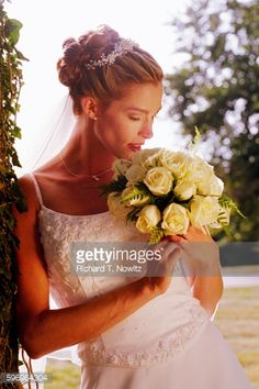 Bride Holding Bouquet Stock Photo | Getty Images