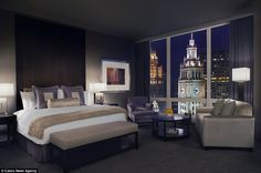 At the five-star Trump Hotel Chicago, luxury rooms overlook the Wrigley Building Clock Tower