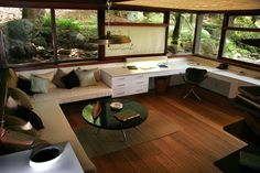 Wright's studio, enveloped by windows, sits at level with the landscape around it.