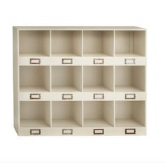 This organization station has 3 rows of four cubbyhole compartments, thick horizontal dividers with rust-finish iron file drawer-type card frames at base of eac
