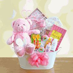 """""""My First Teddy"""" Baby Girl Gift Basket  - Welcome the new baby girl with her first teddy bear!  Snuggled inside our """"My First Teddy"""" Baby Girl Gift Basket is the softest and cutest plush teddy bear in pastel pink for girls with """"My First Teddy"""" embroidered on his foot. $79.95"""