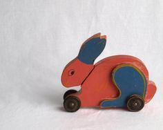Antique rolling bunny toy