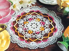Petal Parade Doily Free Crochet Pattern. Bring a touch of spring to any room with the Petal Parade Doily, a pretty, small, round and colorful crochet doily. Pattern More Patterns Like This!
