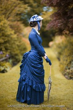 © Lee Avison / Trevillion Images - victorian-woman-standing-on-garden-path