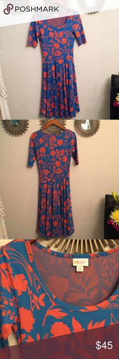 Beautiful NWOT Lularoe nicole dress Coral and sky blue. BEAUTIFUL!!!! Love the fit and style of this dress.. debating on keeping it lol! Hits at the knees. Verry figure flattering! Llr runs a size big. LuLaRoe Dresses Midi