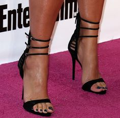 4670ca70c8e8 Amber Rose Flaunts Her Prized Assets in Bandeau LBD and Giuseppe Zanotti  Suede and Satin Cage