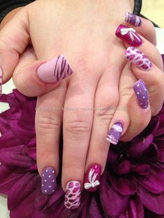 Pink and purple freehand nail art with 3D acrylic bows