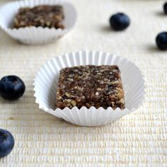 Blueberry Lemon Larabar Squares : altered by adding 1 tablespoon lemon zest, 1/2 tsp lemon extract, 2 scoops Kaizen Vanilla Whey Protein powder, 1 tablespoon homemade sunflower butter, 1 tablespoon water, then after food processing stirring in 1 cup puffed millet and cutting into 14 bars