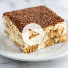 Irresistible tiramisu recipe with espresso soaked ladyfingers layered with a light and airy filling made from mascarpone, egg yolks and cream. Recipe video included.