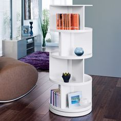 Book shelf - If you want somewhere to store a whole library of books, without taking up a whole library of space - this rotating bookcase is ideal! Simply rotate it to the book you desire. It maximises storage space, while minimising floor space.